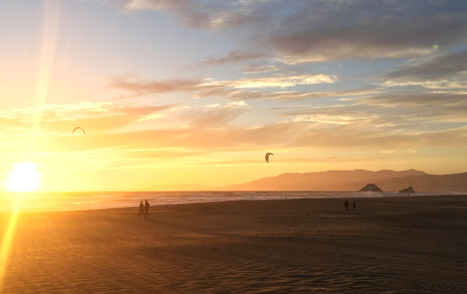 Kitesurfing at Sunset in San Fran Bay Area Coastline